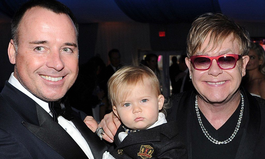 BEVERLY HILLS, CA - FEBRUARY 26: David Furnish, son Zachary and Sir Elton John attend the 20th Annual Elton John AIDS Foundation Academy Awards Viewing Party at The City of West Hollywood Park on February 26, 2012 in Beverly Hills, California. (Photo by Larry Busacca/Getty Images for EJAF) ***BESTPIX***