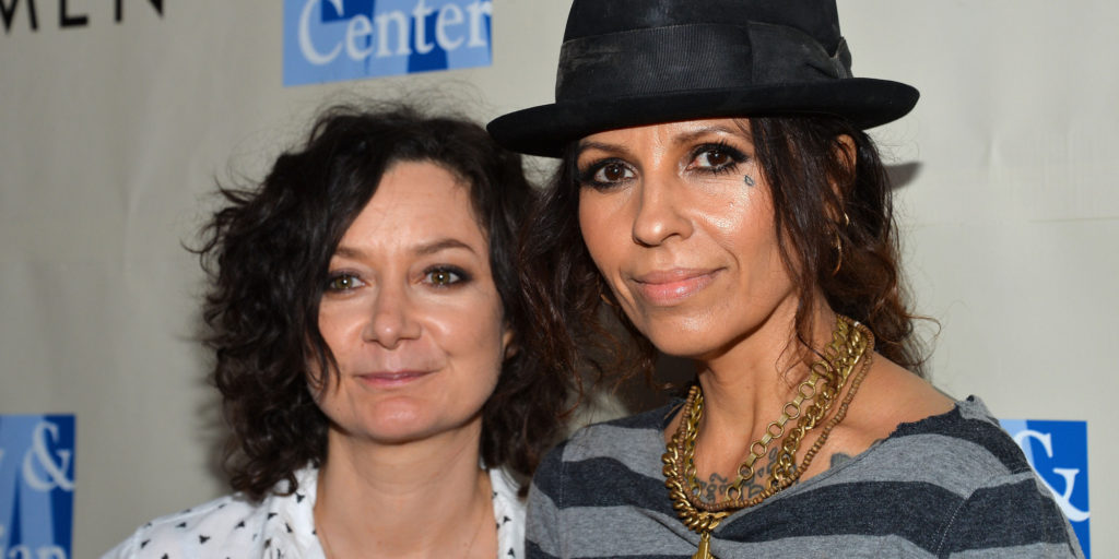 """WEST HOLLYWOOD, CA - MARCH 15: Actress Sara Gilbert (L) and musician Linda Perry arrive at the """"An Evening With Women"""" kick off concert benefiting The L.A. Gay and Lesbian Center at The Roxy Theatre on March 15, 2014 in West Hollywood, California. (Photo by Amanda Edwards/WireImage)"""